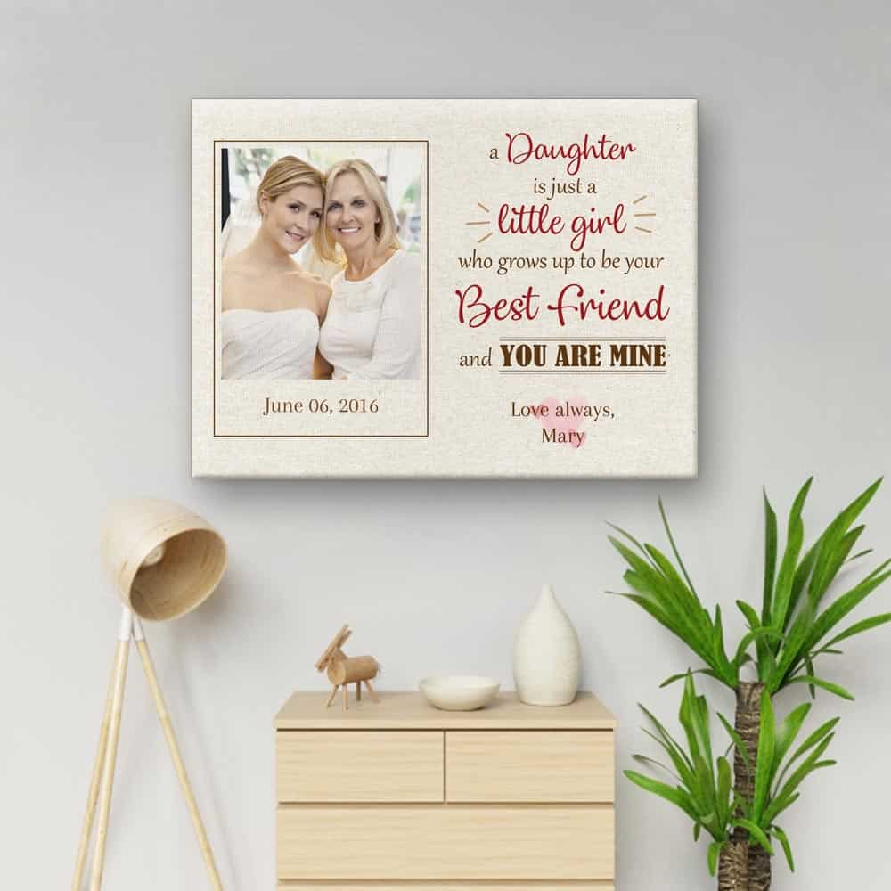 A Daughter Is Just A Little Girl Photo Canvas Print hanging above a cabinet