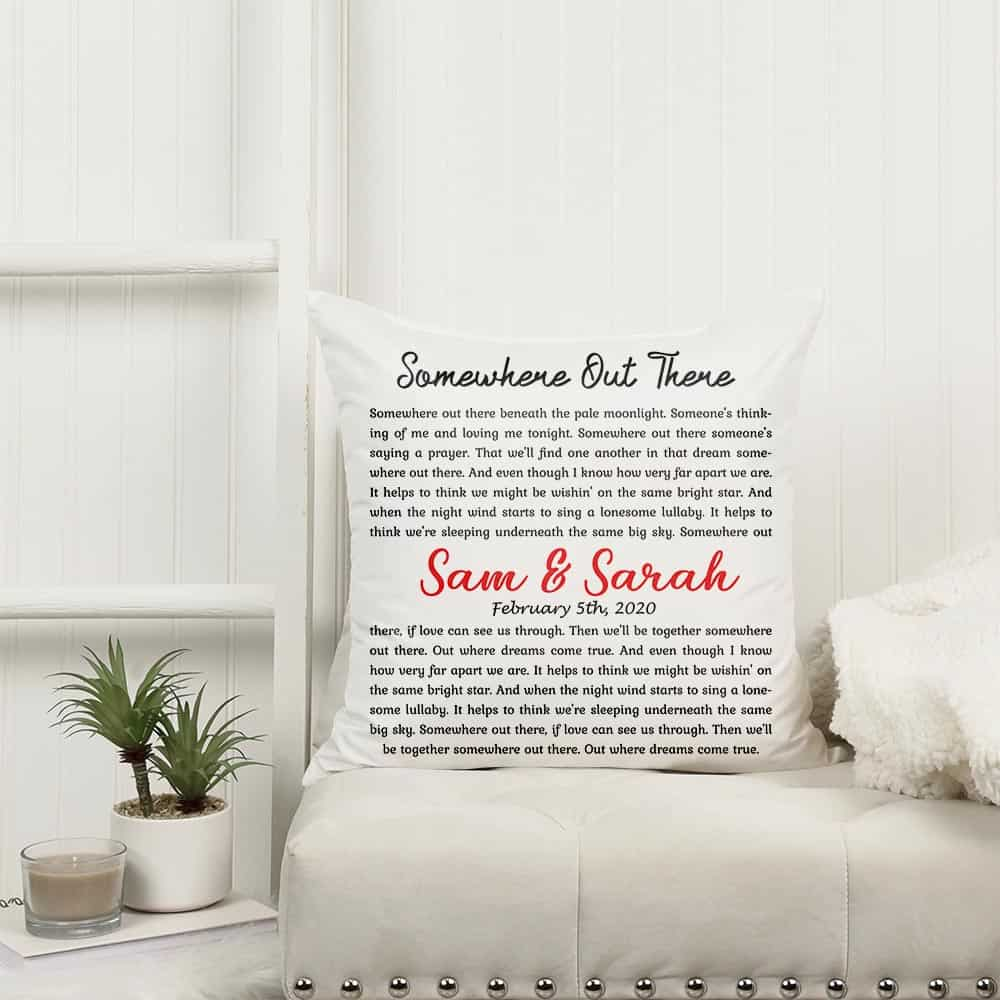 a pillow with personalized song lyrics, names and date