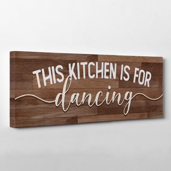 a canvas print sign with the quote this kitchen is for dancing