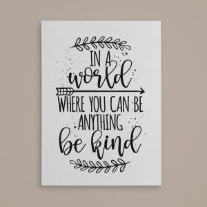 an inspirational canvas print with the quote In A World Where You Can Be Anything Be Kind