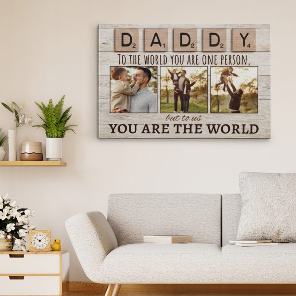 a canvas print with photos and the quote Daddy To The World You Are One Person But To Us You Are The World