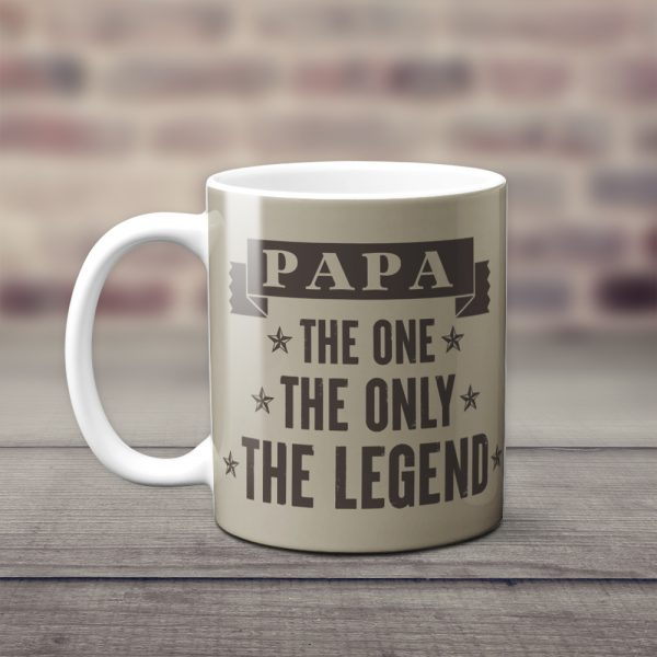 a coffee mug with the words papa the one the only the legend
