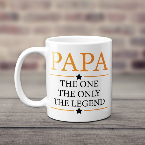 a white coffee mug with the words papa the one the only the legend