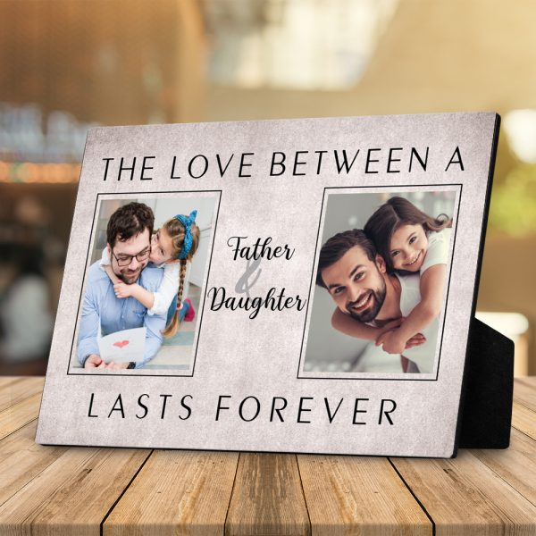 a desktop photo plaque with quote the love between a father and daughter lasts forever